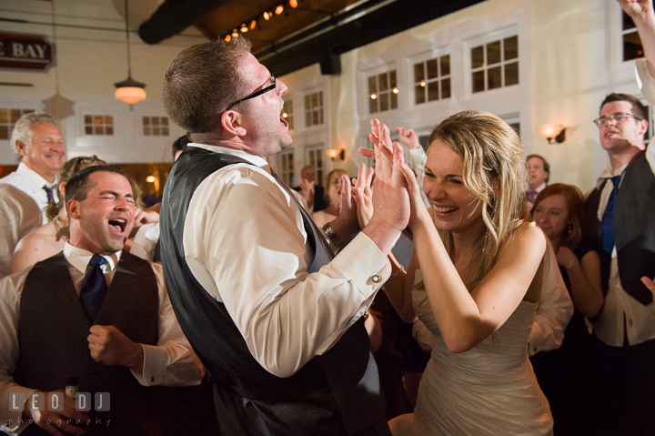 Bride and Groom dancing and laughing together. Kent Island Maryland Chesapeake Bay Beach Club wedding reception party photo, by wedding photographers of Leo Dj Photography. http://leodjphoto.com