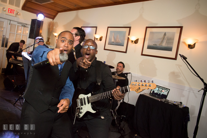 Onyx Band singer and guitarist performing together. Kent Island Maryland Chesapeake Bay Beach Club wedding reception party photo, by wedding photographers of Leo Dj Photography. http://leodjphoto.com