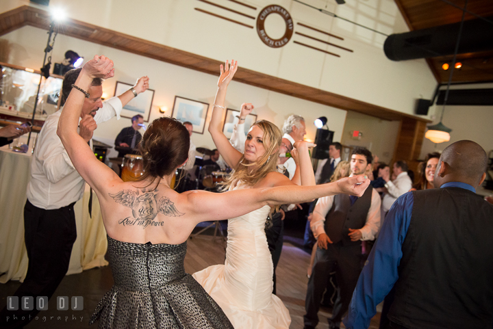 Bride dancing toghether with guest and Father. Kent Island Maryland Chesapeake Bay Beach Club wedding reception party photo, by wedding photographers of Leo Dj Photography. http://leodjphoto.com