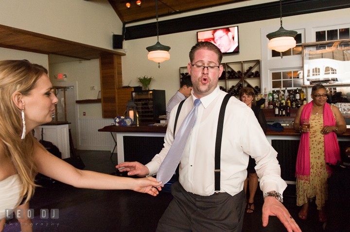 Bride pulling Groom's tie while dancing. Kent Island Maryland Chesapeake Bay Beach Club wedding reception party photo, by wedding photographers of Leo Dj Photography. http://leodjphoto.com