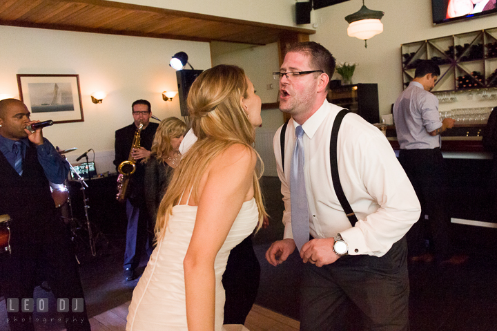 Bride and Groom singing together. Kent Island Maryland Chesapeake Bay Beach Club wedding reception party photo, by wedding photographers of Leo Dj Photography. http://leodjphoto.com