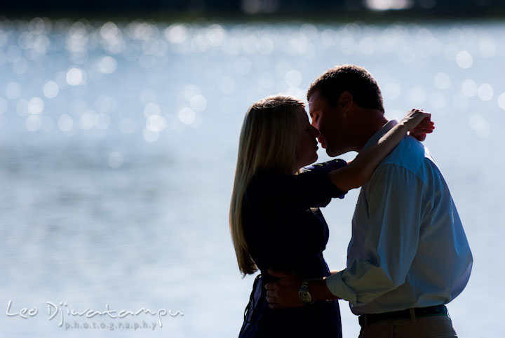 Silhouette of engaged couple almost kissing by the water. Nautical themed pre-wedding engagement photo session at Kent Island, Eastern Shore, Maryland by wedding photographer, Leo Dj Photography