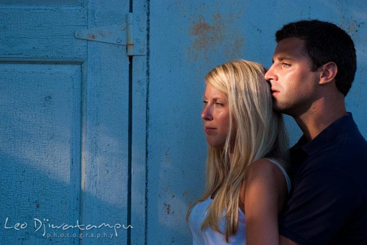 Engaged couple embracing. Nautical themed pre-wedding engagement photo session at Kent Island, Eastern Shore, Maryland by wedding photographer, Leo Dj Photography