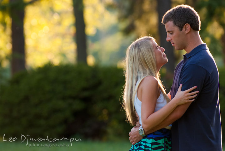 Engaged guy holding close his fiancée. Nautical themed pre-wedding engagement photo session at Kent Island, Eastern Shore, Maryland by wedding photographer, Leo Dj Photography