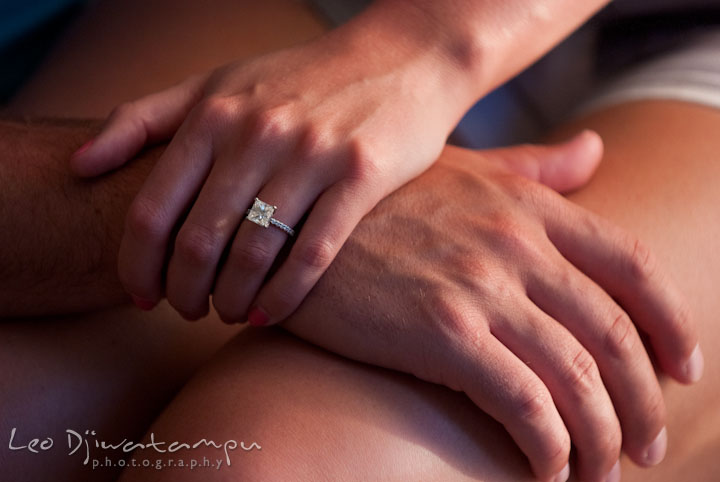 Engaged girl with her engagement ring, holding her fiancé's hand. Nautical themed pre-wedding engagement photo session at Kent Island, Eastern Shore, Maryland by wedding photographer, Leo Dj Photography