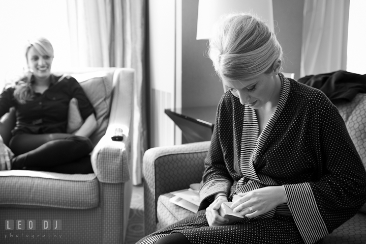 Bride opening gift from Groom. Getting ready wedding photos at Baltimore Marriott Waterfront by photographers of Leo Dj Photography. http://leodjphoto.com