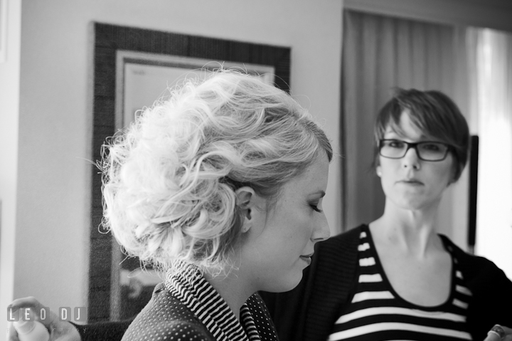 Make up artist spraying Bride's hair. Getting ready wedding photos at Baltimore Marriott Waterfront by photographers of Leo Dj Photography. http://leodjphoto.com