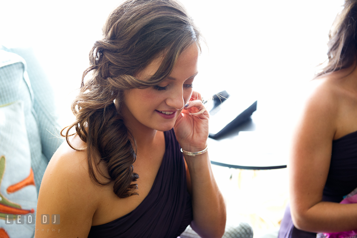 Bridesmaid wearing earrings. Getting ready wedding photos at Baltimore Marriott Waterfront by photographers of Leo Dj Photography. http://leodjphoto.com
