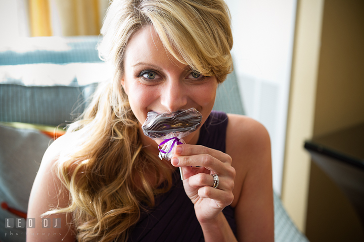 Matron of Honor wearing chocolate mustache. Getting ready wedding photos at Baltimore Marriott Waterfront by photographers of Leo Dj Photography. http://leodjphoto.com