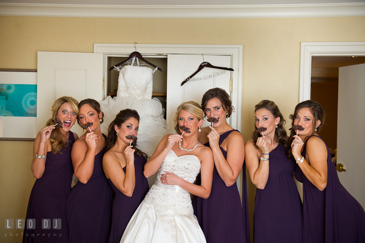 Bride, Matron of Honor, and Bridesmaids posing with chocolate mustache. Getting ready wedding photos at Baltimore Marriott Waterfront by photographers of Leo Dj Photography. http://leodjphoto.com