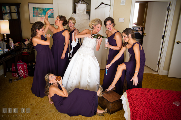 Bride, Matron of Honor, and Bridesmaids doing silly poses. Getting ready wedding photos at Baltimore Marriott Waterfront by photographers of Leo Dj Photography. http://leodjphoto.com