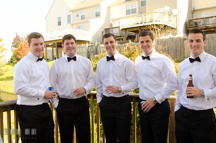 Groom, Best Man, and Groomsmen drinking outside on the terrace. Getting ready wedding photos at Baltimore Marriott Waterfront by photographers of Leo Dj Photography. http://leodjphoto.com
