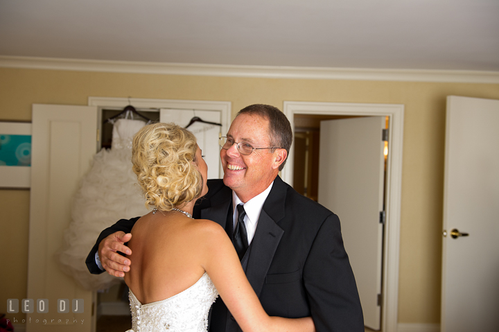 Father of Bride hugging daughter. Getting ready wedding photos at Baltimore Marriott Waterfront by photographers of Leo Dj Photography. http://leodjphoto.com