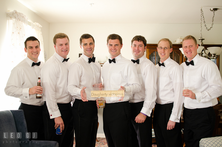 Groom, Best Man, and Groomsmen posing with sign. Getting ready wedding photos at Baltimore Marriott Waterfront by photographers of Leo Dj Photography. http://leodjphoto.com