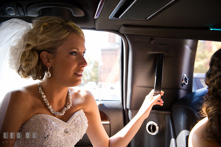 Bride inside the limo. Getting ready wedding photos at Baltimore Marriott Waterfront by photographers of Leo Dj Photography. http://leodjphoto.com