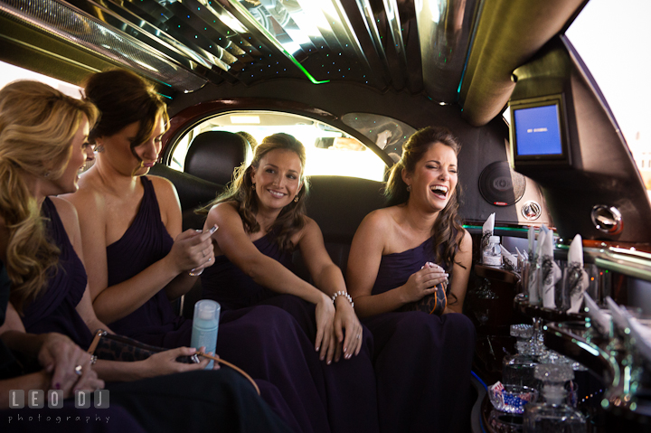 Maid of Honor and Bridesmaids laughing and having fun inside the limo. Getting ready wedding photos at Baltimore Marriott Waterfront by photographers of Leo Dj Photography. http://leodjphoto.com