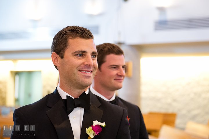 Groom and Best Man looking at Bride in wedding gown the first time. Ceremony wedding photos at Sacred Heart Church, Glyndon, Maryland by photographers of Leo Dj Photography. http://leodjphoto.com