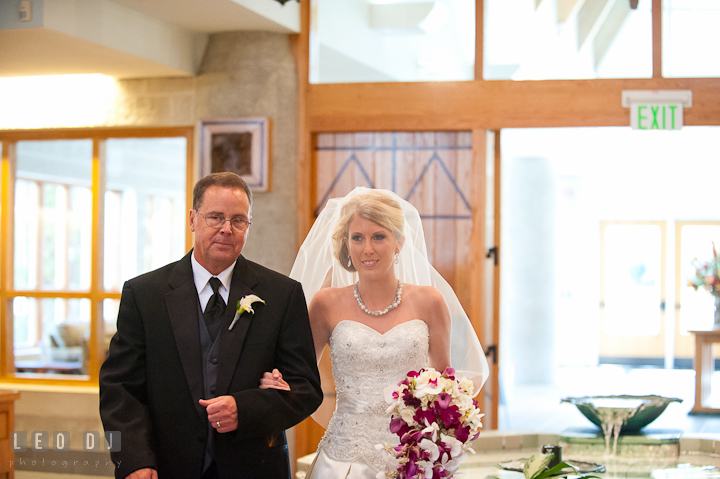 Father of the Bride escorting daughter walking down the isle. Ceremony wedding photos at Sacred Heart Church, Glyndon, Maryland by photographers of Leo Dj Photography. http://leodjphoto.com