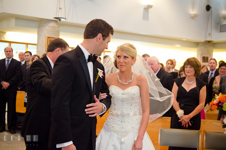 Father of Bride gave away daughter to Groom. Ceremony wedding photos at Sacred Heart Church, Glyndon, Maryland by photographers of Leo Dj Photography. http://leodjphoto.com