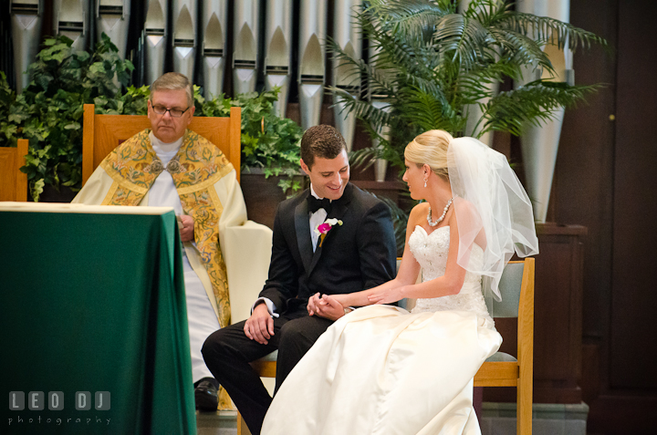 Groom and Bride smiling together during ceremony. Ceremony wedding photos at Sacred Heart Church, Glyndon, Maryland by photographers of Leo Dj Photography. http://leodjphoto.com