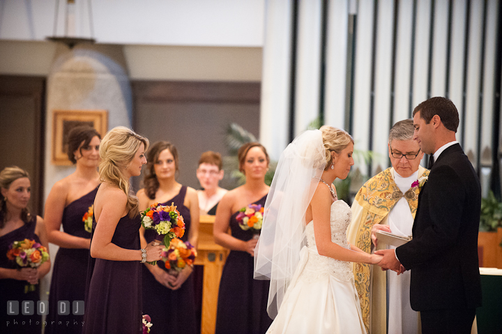Bride and Groom exchanging wedding rings. Ceremony wedding photos at Sacred Heart Church, Glyndon, Maryland by photographers of Leo Dj Photography. http://leodjphoto.com