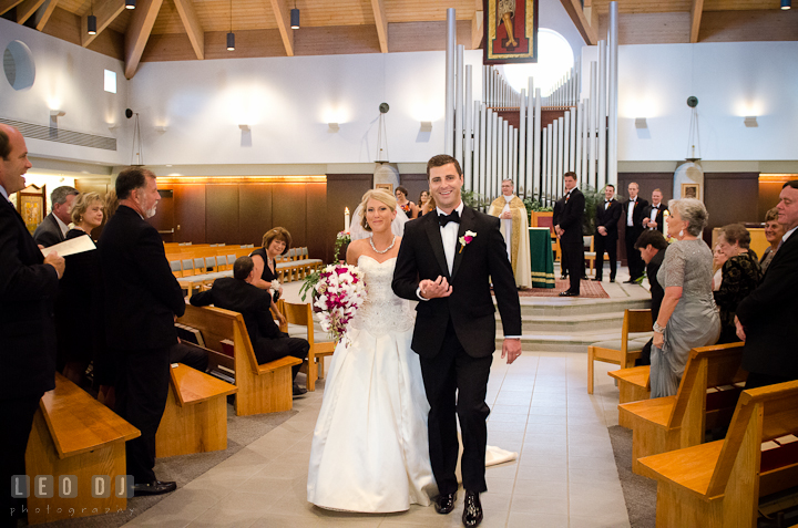 Bride and Groom walking out of the isle. Ceremony wedding photos at Sacred Heart Church, Glyndon, Maryland by photographers of Leo Dj Photography. http://leodjphoto.com