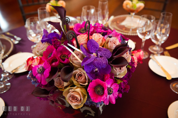 Blue, purple and pink floral table centerpiece by Intrigue Design and Decor. Chesapeake Bay Beach Club wedding bridal testing photos by photographers of Leo Dj Photography. http://leodjphoto.com