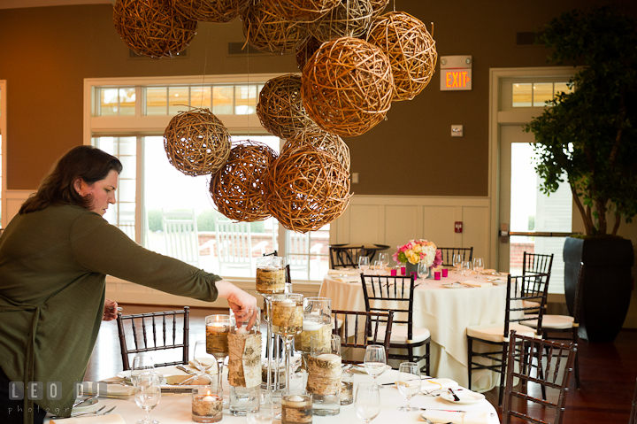 Sarah Campbell-Angers of  Intrige Design and Decor applying finishing touch to table centerpiece. Chesapeake Bay Beach Club wedding bridal testing photos by photographers of Leo Dj Photography. http://leodjphoto.com