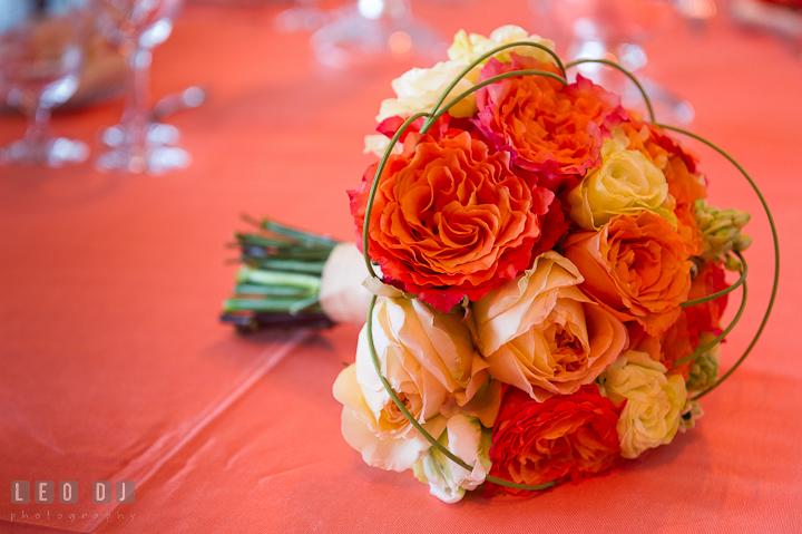 Orange floral bouquet by Intrige Design and Decor. Chesapeake Bay Beach Club wedding bridal testing photos by photographers of Leo Dj Photography. http://leodjphoto.com