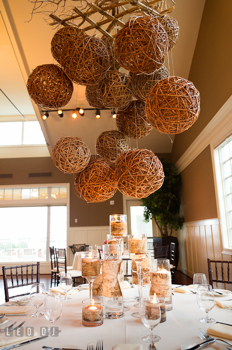 Suspended rattan balls and glass candle holders with birch tree barks as table centerpiece by Intrige Design and Decor. Chesapeake Bay Beach Club wedding bridal testing photos by photographers of Leo Dj Photography. http://leodjphoto.com