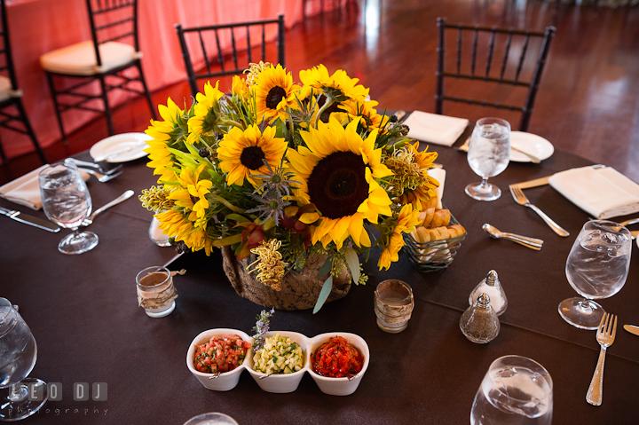 Sunflower floral arrangement table centerpiece by Intrige Design and Decor. Chesapeake Bay Beach Club wedding bridal testing photos by photographers of Leo Dj Photography. http://leodjphoto.com