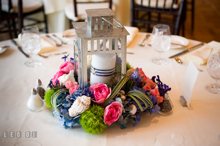 Candle lantern and flowers table centerpiece by Intrige Design and Decor. Chesapeake Bay Beach Club wedding bridal testing photos by photographers of Leo Dj Photography. http://leodjphoto.com