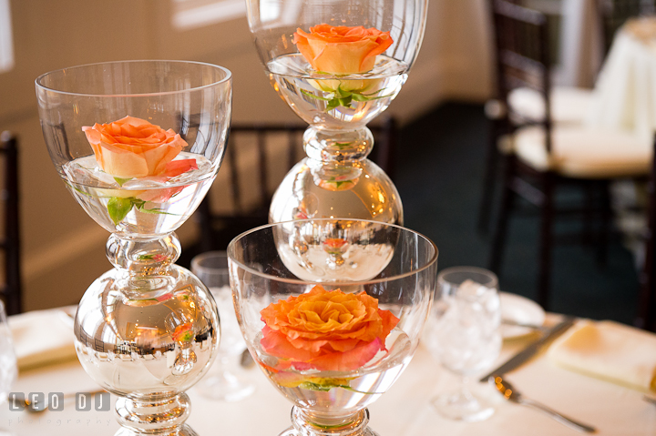 Glass and silver vase with orange rose table centerpieces by Intrige Design and Decor. Chesapeake Bay Beach Club wedding bridal testing photos by photographers of Leo Dj Photography. http://leodjphoto.com