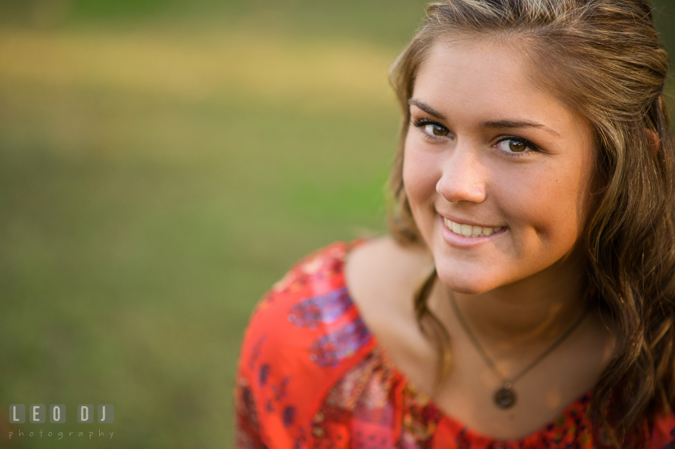 Close up picture of girl smiling with dimple. Eastern Shore, Maryland, Queen Anne's County High School senior portrait session by photographer Leo Dj Photography. http://leodjphoto.com