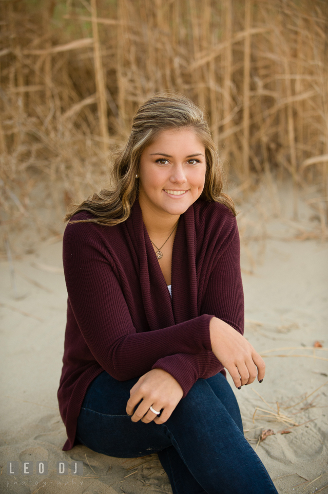 Beautiful girl sitting on beach sand. Eastern Shore, Maryland, Queen Anne's County High School senior portrait session by photographer Leo Dj Photography. http://leodjphoto.com