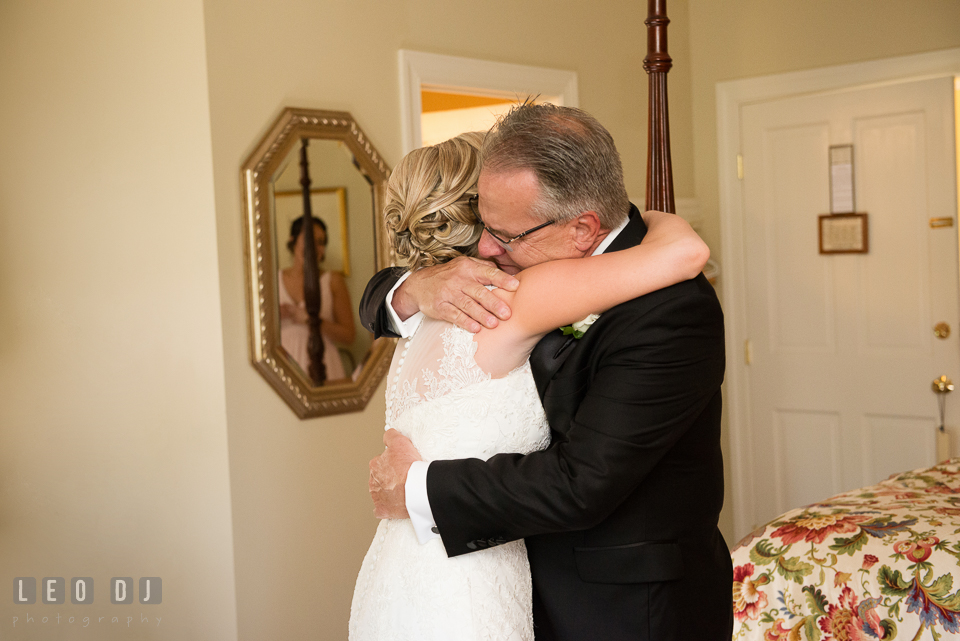 Eastern Shore Maryland bride hugging father during first look photo by Leo Dj Photography