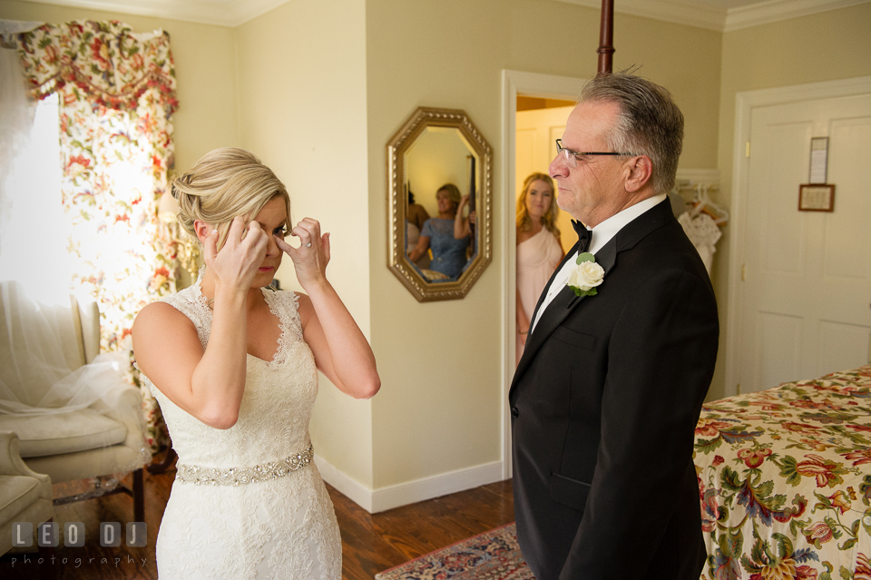 Kent Island Maryland bride wiping off tears during first look with Dad photo by Leo Dj Photography