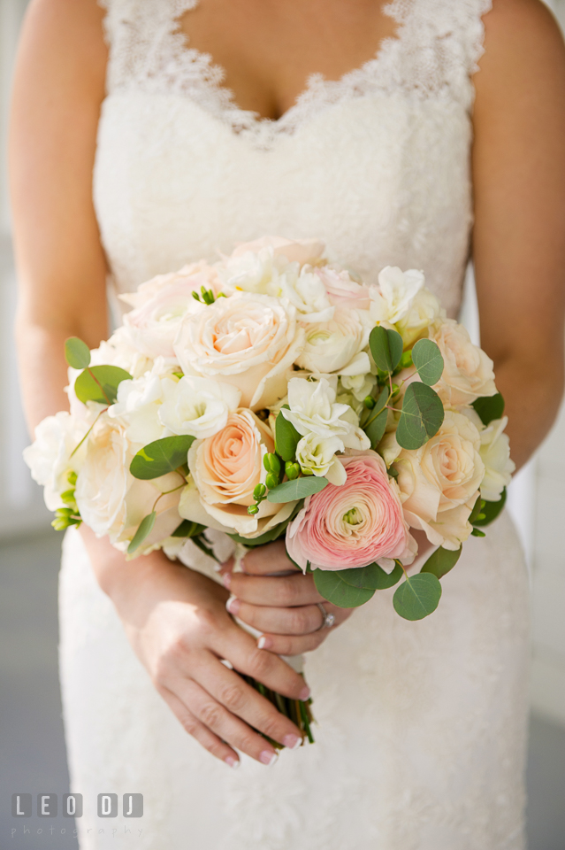 Kent Manor Inn bride holding pink and white rose bouquet by Cache Fleur photo by Leo Dj Photography