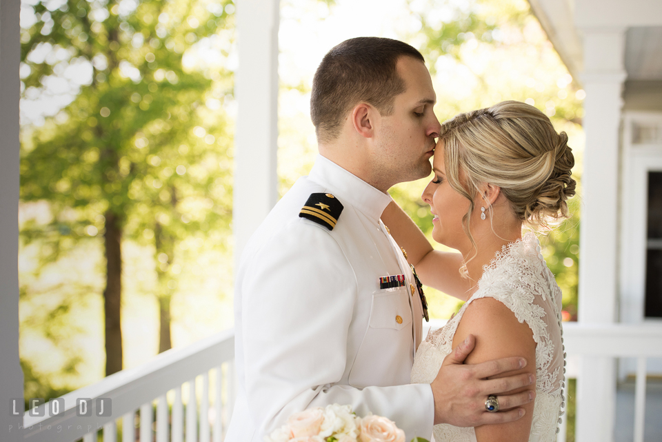 Kent Manor Inn groom kissed bride during first look photo by Leo Dj Photography