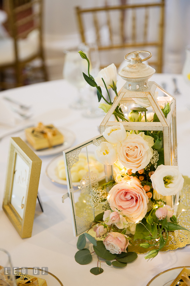 Kent Island Maryland wedding dining table centerpiece with rose and lantern by Cache Fleur photo by Leo Dj Photography