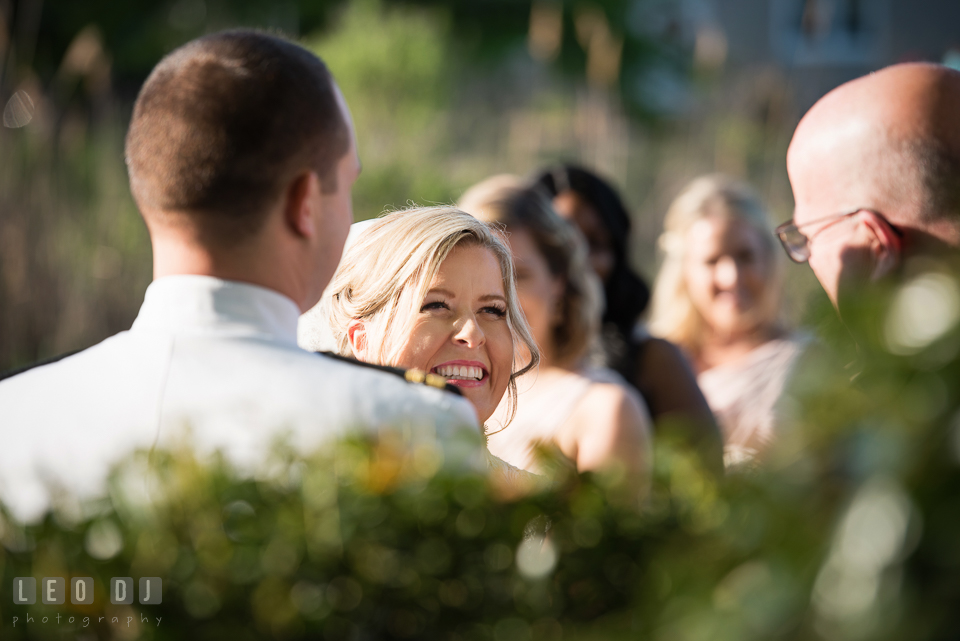 Kent Manor Inn bride laughing during wedding ceremony photo by Leo Dj Photography