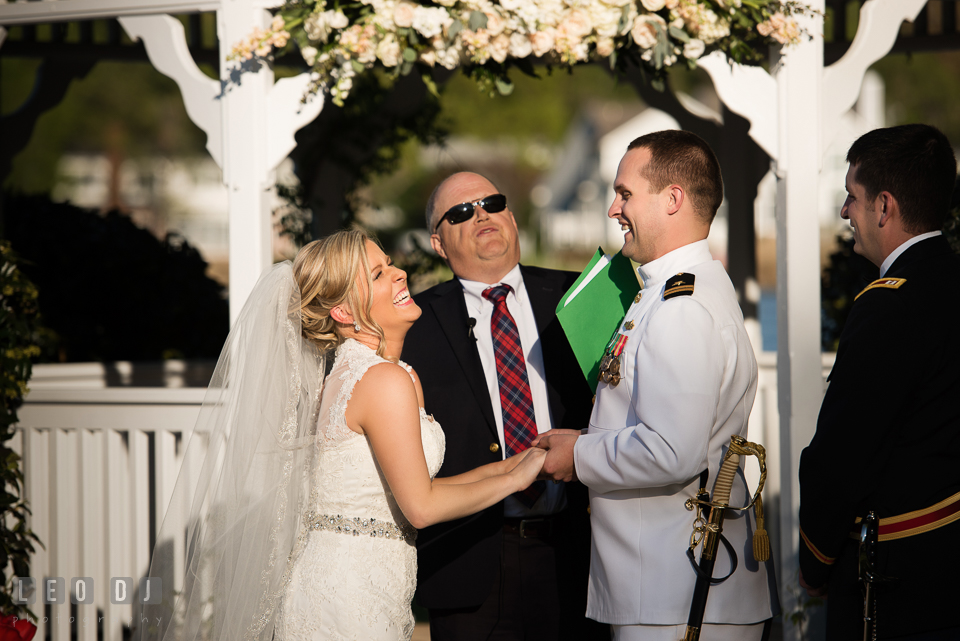 Kent Manor Inn wedding ceremony bride and groom laughing during wedding vow photo by Leo Dj Photography