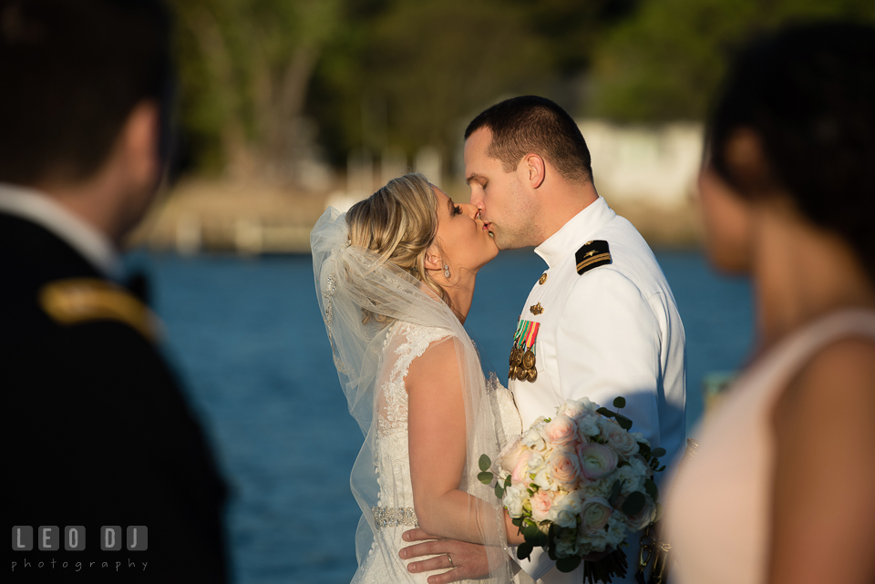 Kent Manor Inn bride and groom kissing seen by Maid of Honor and Best Man photo by Leo Dj Photography