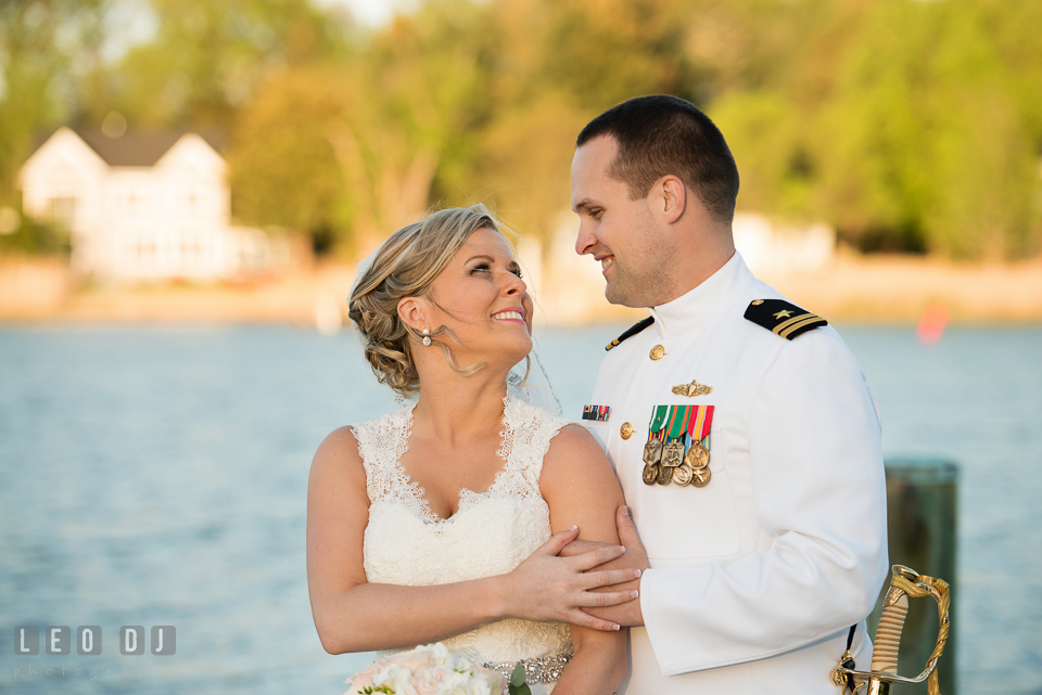 Kent Manor Inn groom embracing bride on the dock with water view photo by Leo Dj Photography