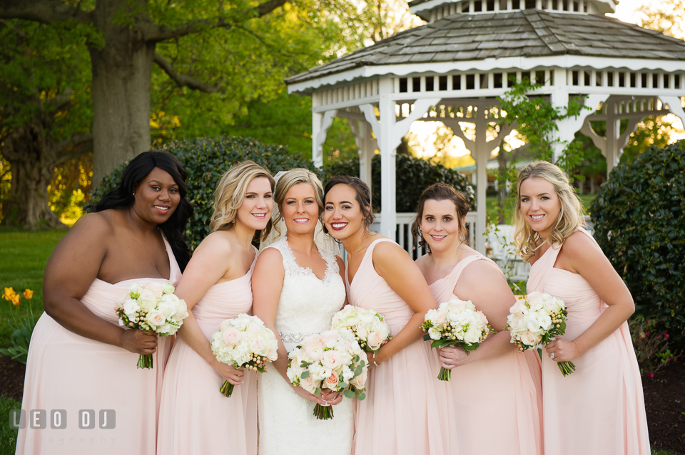 Kent Manor Inn Bride, Maid of Honor, and Bridesmaids posing by the gazebo photo by Leo Dj Photography
