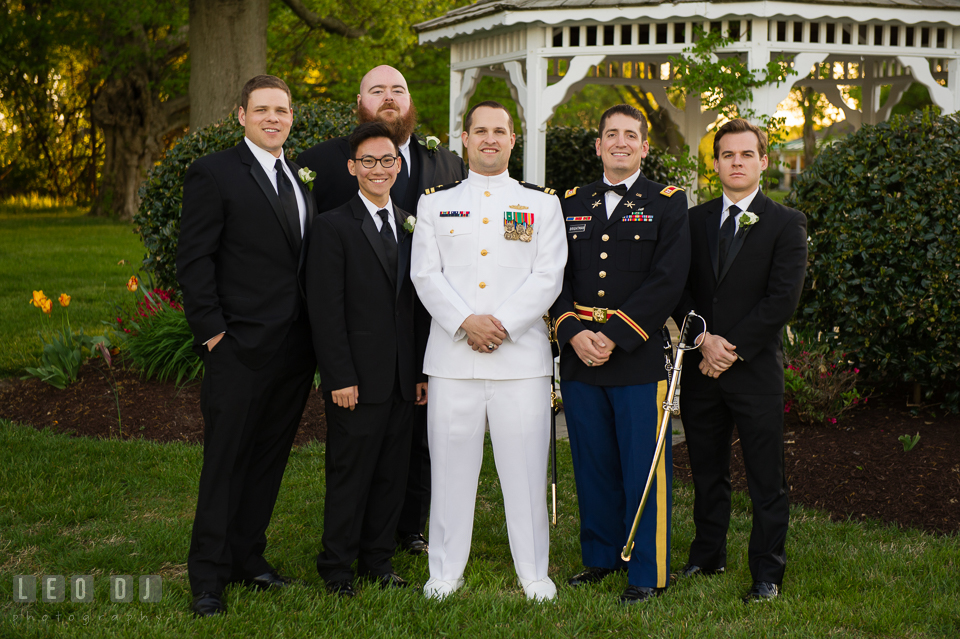 Kent Manor Inn Groom, Best Man, and Groomsmen posing by the gazebo photo by Leo Dj Photography