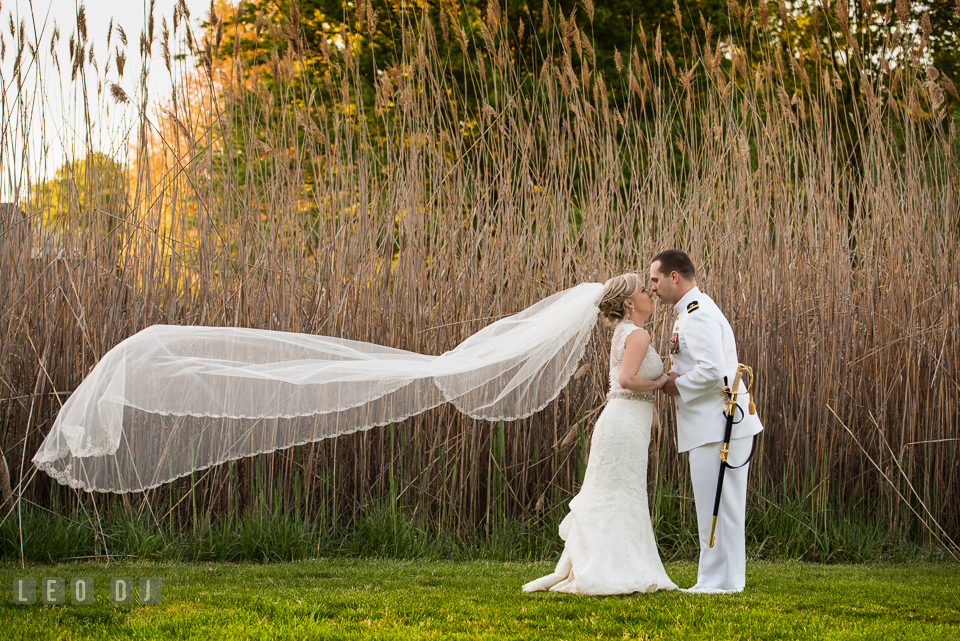 Kent Manor Inn bride with long flowing wedding gown veil almost kiss groom photo by Leo Dj Photography