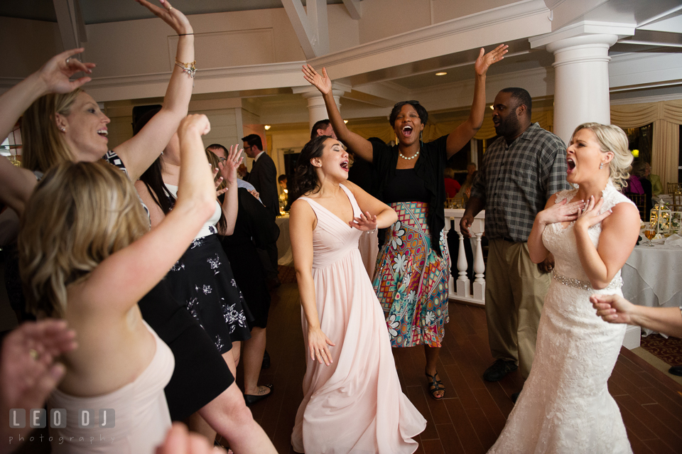 Kent Island Maryland Bride and guests dancing and singing with music from Crow Entertainment DJ at wedding reception photo by Leo Dj Photography