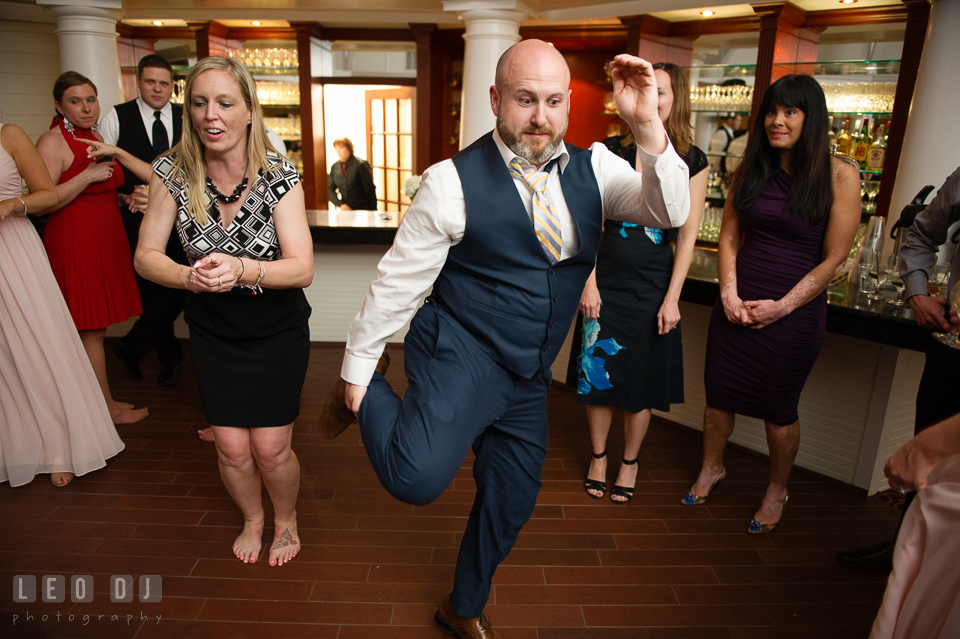 Kent Island Maryland guest dance holding his leg at wedding reception photo by Leo Dj Photography