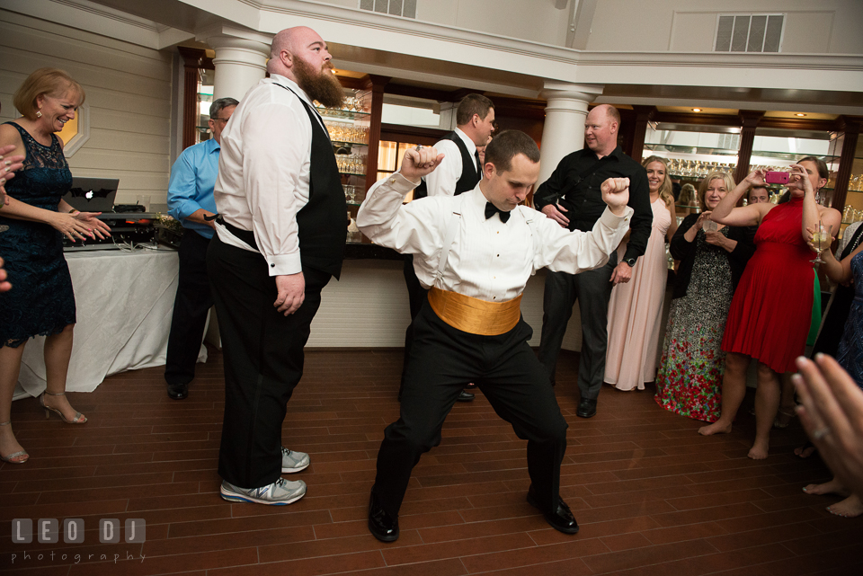 Eastern Shore Maryland Groom dancing to music by Crow Entertainment DJ at wedding reception photo by Leo Dj Photography